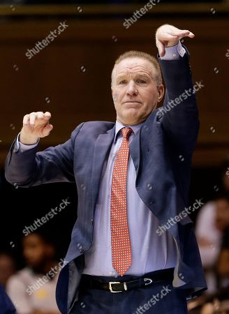 St. John's head coach Chris Mullin directs his players during the first half of an NCAA college basketball game against Duke in Durham, N.C
