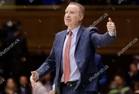 St. John's head coach Chris Mullin reacts during the first half of an NCAA college basketball game against Duke in Durham, N.C