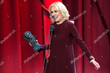 """Stock Photo of Spanish actress Susi Sanchez celebrates her Goya award as best leading actress for the film """"La enfermedad del domingo"""" during the Goya Film Awards Ceremony in Seville, Spain"""