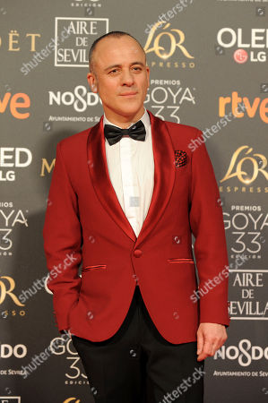 Spanish actor Javier Gutierrez poses for photographers on the red carpet ahead of the Goya Film Awards Ceremony in Seville, Spain