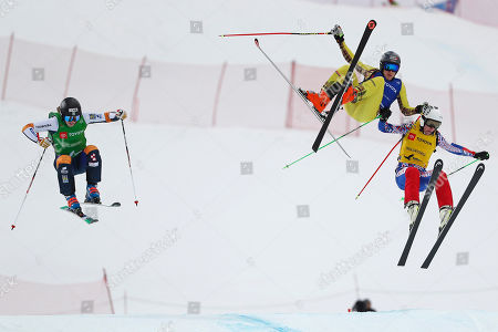 David Green of Sweden (L) Tim Hronek of Germany (C), and Maxim Vikhrov of Russia (R) take the final jump before the finish line in the Men's Ski Cross competition at Solitude Mountain Resort for the FIS World Championships in Solitude, Utah, 02 February 2019.