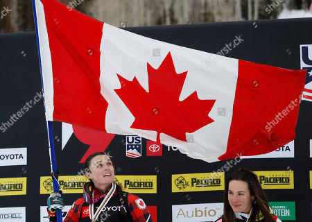 Marielle Thompson of Canada (L) celebrates winning the Ladies' Ski Cross competition next to Alizee Baron of France at Solitude Mountain Resort for the FIS World Championships in Solitude, Utah, USA, 02 February 2019.