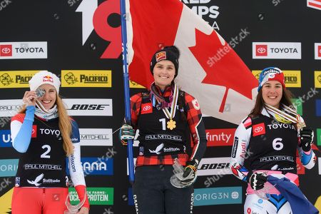 Silver medalist Fanny Smith, left, of Switzerland; gold medalist Marielle Thompson, center, of Canada; and bronze medalist Alizee Baron, of France, celebrate on the podium after the women's ski cross event at the freestyle ski and snowboard world championships, in Solitude, Utah