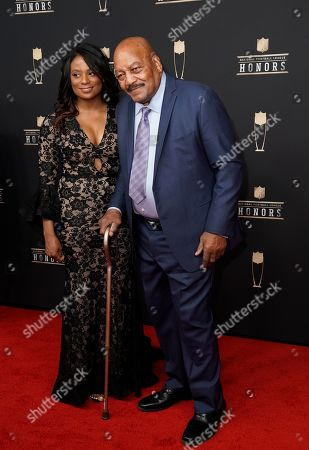 Monique Brown, Jim Brown. Former NFL player Jim Brown, right, and Monique Brown arrive at the 8th Annual NFL Honors at The Fox Theatre, in Atlanta