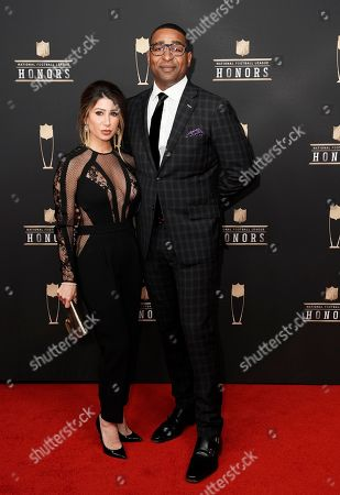 Stock Photo of Susanna Baumann, Cris Carter. Former NFL player Cris Carter, right, and Susanna Baumann arrive at the 8th Annual NFL Honors at The Fox Theatre, in Atlanta