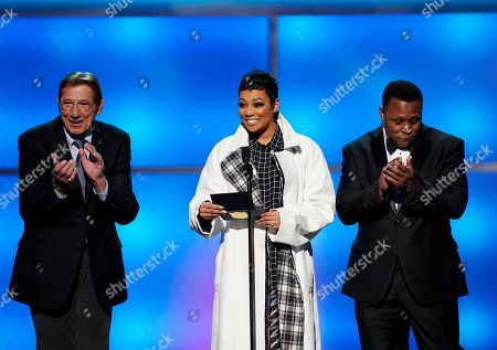 Joe Namath, Monica, Barry Sanders. Former NFL player Joe Namath, from left, Monica, and former NFL player Barry Sanders the award for AP coach of the year at the 8th Annual NFL Honors at The Fox Theatre, in Atlanta