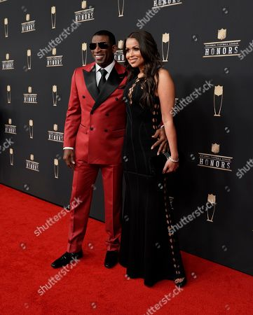 Stock Image of Deion Sanders, Tracey Edmonds. Former NFL player Deion Sanders, left, and Tracey Edmonds arrive at the 8th Annual NFL Honors at The Fox Theatre, in Atlanta