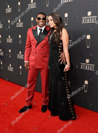 Stock Photo of Deion Sanders, Tracey Edmonds. Former NFL player Deion Sanders, left, and Tracey Edmonds arrive at the 8th Annual NFL Honors at The Fox Theatre, in Atlanta