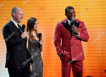 Stock Photo of From left, Rich Eisen, Kay Adams and Deion Sanders at the 8th Annual NFL Honors at The Fox Theatre, in Atlanta