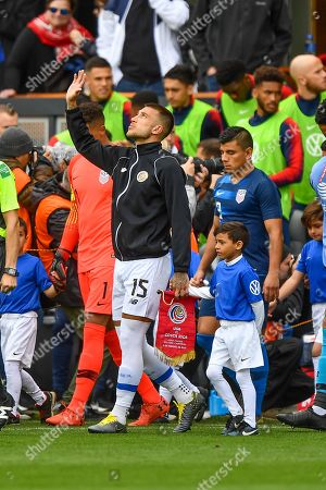 Costa Rica defender Francisco Calvo (15) takes the field before the international friendly soccer match between Costa Rica and the United States at Avaya Stadium in San Jose, California *** Corrects an earlier version filed under an incorrect headline