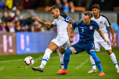 Costa Rica defender Francisco Calvo (15) fights Unites States defender Corey Baird (7) for possession during the international friendly soccer match between Costa Rica and the United States at Avaya Stadium in San Jose, California