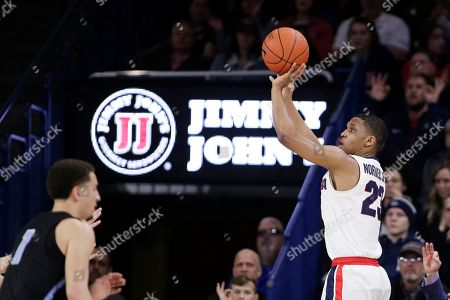 Gonzaga guard Zach Norvell Jr. (23) shoots near San Diego guard Tyler Williams (1) during the second half of an NCAA college basketball game in Spokane, Wash
