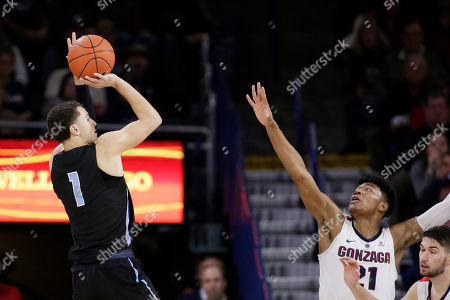 San Diego guard Tyler Williams (1) shoots over Gonzaga forward Rui Hachimura during the second half of an NCAA college basketball game in Spokane, Wash