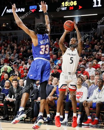 Trevor Moore, Jimmy Whitt Jr. Cincinnati's Trevor Moore (5) shoots over SMU's Jimmy Whitt Jr. (33) in the first half of an NCAA college basketball game, in Cincinnati