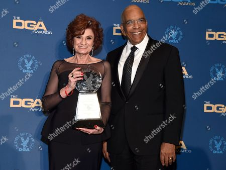 Stock Image of Mimi Deaton, Stan Lathan. Mimi Deaton, left, winner of the Franklin J. Schaffner Achievement Award poses with Stan Lathan in the press room at the 71st annual DGA Awards at the Ray Dolby Ballroom, in Los Angeles