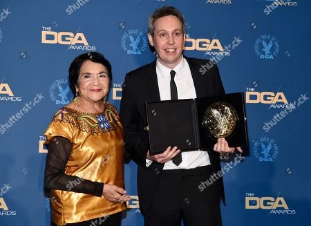 """Dolores Huerta, Tim Wardle. Dolores Huerta, left, poses with Tim Wardle, winner of the award for outstanding directorial achievement in documentary for """"Three Identical Strangers"""" at the 71st annual DGA Awards at the Ray Dolby Ballroom, in Los Angeles"""