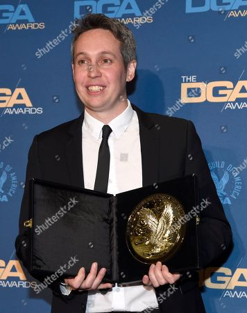 """Stock Picture of Tim Wardle poses in the press room with the award for outstanding directorial achievement in documentary for """"Three Identical Strangers"""" at the 71st annual DGA Awards at the Ray Dolby Ballroom, in Los Angeles"""
