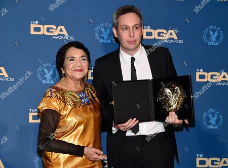 """Stock Picture of Dolores Huerta, Tim Wardle. Dolores Huerta, left, poses with Tim Wardle, winner of the award for outstanding directorial achievement in documentary for """"Three Identical Strangers"""" at the 71st annual DGA Awards at the Ray Dolby Ballroom, in Los Angeles"""