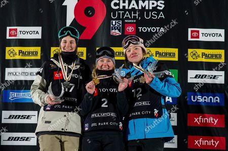 Second-place Julia Krass, of the United States; winner Tess Ledeux, of France; and third-place Isabel Atkin, of Britain, from left, stand on the podium after the women's big air at the freestyle ski and snowboard world championships, Park City, Utah