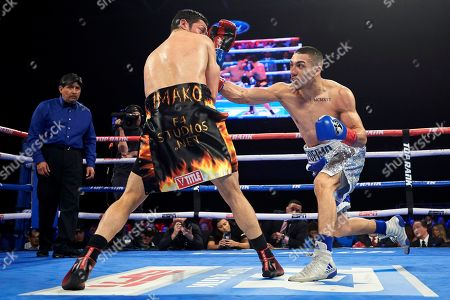 Teofimo Lopez, right, hits Diego Magdaleno during lightweight boxing match, in Frisco, Texas