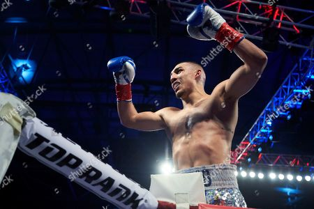 Teofimo Lopez celebrates after defeating Diego Magdaleno during a lightweight boxing match, in Frisco, Texas
