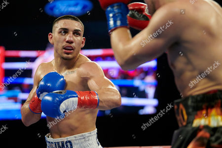 Stock Picture of Teofimo Lopez, left, faces off against Diego Magdaleno during a lightweight boxing match, in Frisco, Texas