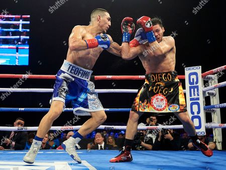 Teofimo Lopez, left, hits Diego Magdaleno during a lightweight boxing match, in Frisco, Texas