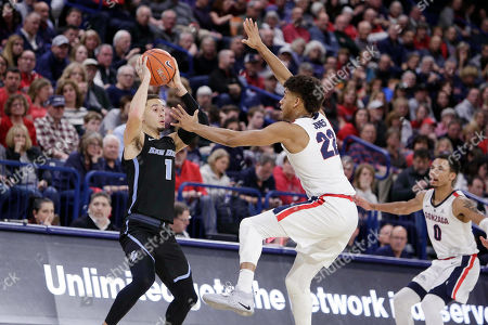 San Diego guard Tyler Williams (1) looks to pass while defended by Gonzaga forward Jeremy Jones (22) during the second half of an NCAA college basketball game in Spokane, Wash