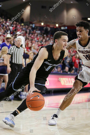 San Diego guard Tyler Williams (1) drives the ball while defended by Gonzaga forward Brandon Clarke during the second half of an NCAA college basketball game in Spokane, Wash