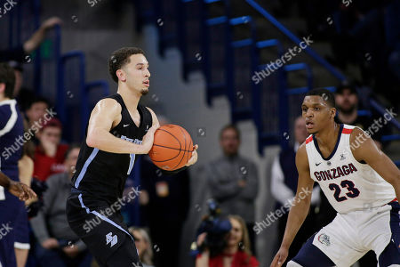 San Diego guard Tyler Williams (1) prepares to pass the ball in front of Gonzaga guard Zach Norvell Jr. (23) during the first half of an NCAA college basketball game in Spokane, Wash