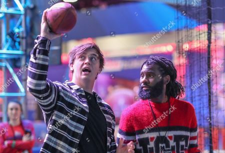 Stock Photo of Rapper/Grime Artist Jermaine  Sinclair , better known by his stage name Wretch 32.with British Atlanta Falcon's Player Alex Gray    Picture Dave Shopland/NFL