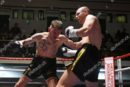 John Brennan (black/gold shorts) defeats Andre Moravec during a Boxing Show at York Hall on 2nd February 2019