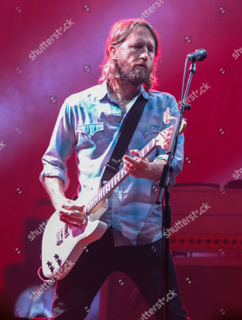 Chris Shiflett with Foo Fighters performs during the DIRECTV Super Saturday Night at Atlantic Station, in Atlanta