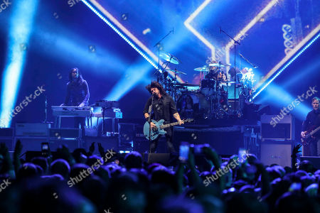Dave Grohl, Nate Mendel, Pat Smear, Taylor Hawkins, Chris Shiflett, Rami Jaffee. Dave Grohl, Nate Mendel, Pat Smear, Taylor Hawkins, Chris Shiflett and Rami Jaffee with Foo Fighters performs during the DIRECTV Super Saturday Night at Atlantic Station, in Atlanta