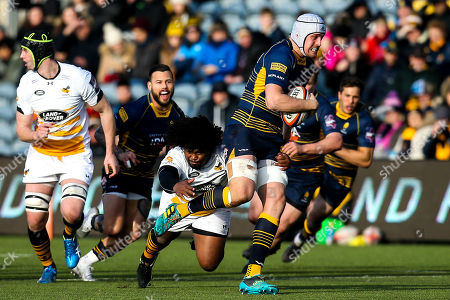 Pierce Phillips of Worcester Warriors goes past Ashley Johnson of Wasps
