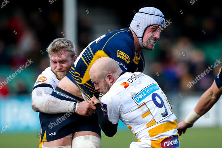 Pierce Phillips of Worcester Warriors is tackled by Joe Simpson and Ben Morris of Wasps