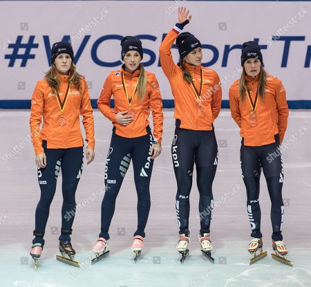 Netherland's Lara van Ruijven, Rianne de Vries, Suzanne Schulting, Yara van Kerkhof pose for photo after winning second place in the 3000m mix gender relay final at the ISU World Cup Short Track Speed Skating in Dresden, Germany, 03 February 2019.