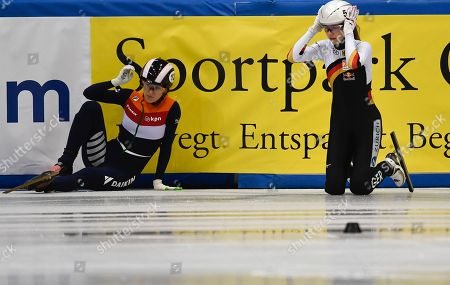 Anna Seidel (R) of Germany and Rianne de Vries  of Netherlands react after they crash during the women's 100m semi final at the ISU World Cup Short Track Speed Skating in Dresden, Germany, 03 February 2019.