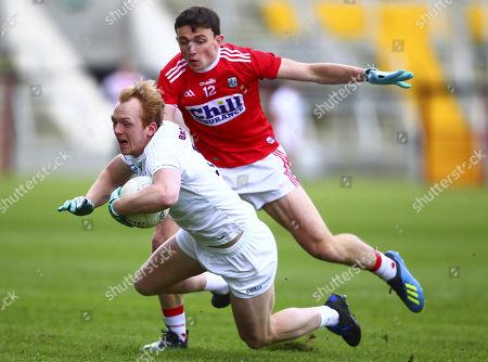 Cork vs Kildare. Kildare's Keith Cribbin is tackled by Cork's Mark Collins