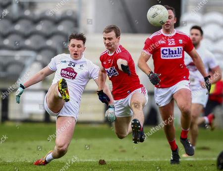 Cork vs Kildare. Kildare's Neil Flynn shoots under pressure from Cork's Mathew Taylor