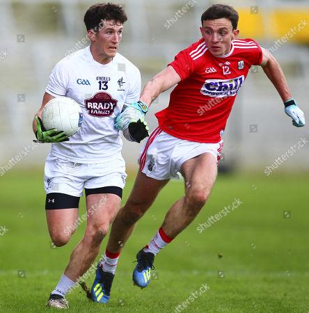 Cork vs Kildare. Kildare's David Slattery in action against Cork's Mark Collins