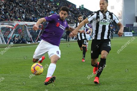 Fiorentina's Giovanni Simeone (L) and Udinese's William Troost-Ekong (R) in action during  the Italian Serie A soccer match Udinese vs Fiorentina at Friuli stadium in Udine, Italy, 3 February 2019.