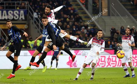 Inter's Lautaro Martinez and Bologna's Giancarlo Gonzalez (up) in action during the Italian Serie A soccer match FC Inter vs Bologna FC at the Giuseppe Meazza stadium in Milan, Italy, 03 February 2019.