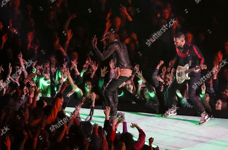 Stock Image of Travis Scott performs alongside Adam Levine of Maroon 5 during the half-time show