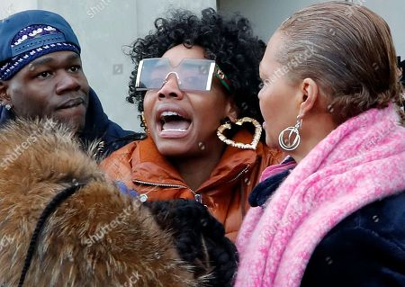 Yandy Smith, center, gasps for air as people come to her aid after she was sprayed with pepper spray and thrown to the ground after storming the main entrance of the Metropolitan Detention Center, a federal prison with all security levels, during a demonstration with protesters and prisoners' family members, in New York. The prison has been without heat, hot water, electricity and sanitation since earlier in the week, including through the recent frigid weather