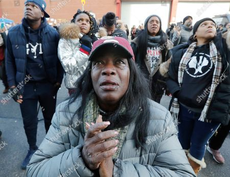 Stock Photo of Cahana Yehuda, 50, center, of the Bronx, sheds tears as she hears the response of prisoners held inside the Metropolitan Detention Center, a federal facility with all security levels, in New York. Yehuda's brother Jason Smith is serving 18 months for gun possession. He has been in prison since June 2018. The prison has been without heat, hot water, electricity and good sanitation for several days, including during the recent frigid weather
