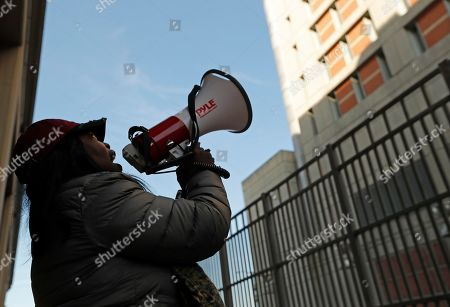 Stock Image of Catana Yehudah, 50, of the Bronx, uses a megaphone to speak to prisoners from outside the Metropolitan Detention Center, a federal prison of all security levels, where inmates haven't had access to heat, hot water, electricity and flushing toilets since earlier in the week, including throught the recent frigid old snap, in New York. Yehudah's brother Jason Smith, 40, is serving an 18-month sentence for gun possession