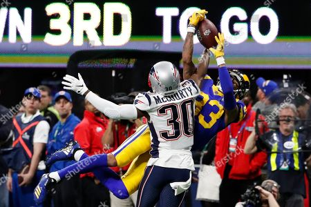 New England Patriots cornerback Jason McCourty (L) breaks up the pass play against Los Angeles Rams wide receiver Josh Reynolds (R) during the first half of Super Bowl LIII between the New England Patriots and the Los Angeles Rams at Mercedes-Benz Stadium in Atlanta, Georgia, USA, 03 February 2019.