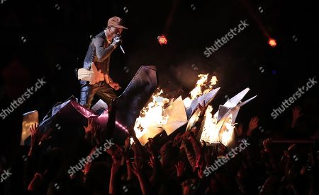 Travis Scott performs during the halftime show of Super Bowl LIII between the New England Patriots and the Los Angeles Rams at Mercedes-Benz Stadium in Atlanta, Georgia, USA, 03 February 2019.