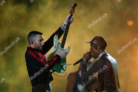 Stock Picture of Rapper Travis Scott and Maroon 5's Adam Levine perform during the half time show of Super Bowl LIII between the New England Patriots and the Los Angeles Rams at Mercedes-Benz Stadium in Atlanta, Georgia, USA, 03 February 2019.